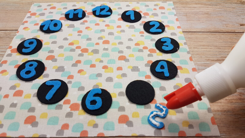 Glue or sew all the numbers on black circles.