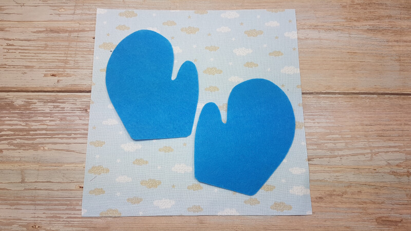 Step 2 - glue or sew blue gloves on the prepared page.