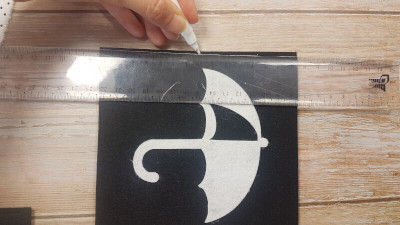 Mark a center of the sheet.