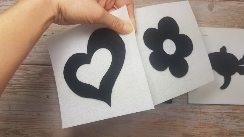 Put a heart and a flower felt together.